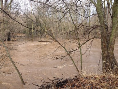 A view of the swollen Sheboygan River along County PP April 14, 2014.
