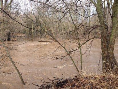 A view of the swollen Sheboygan River along County PP April 14, 2014.