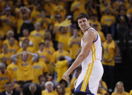Golden State Warriors Andrew Bogut reacts during their loss to the San Antonio Spurs in their NBA Western Conference semi-final playoff bask