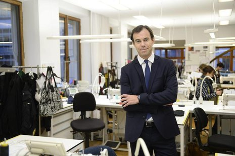 Swedish retailer Hennes & Mauritz Chief Executive Karl-Johan Persson poses for pictures at the company's office in Stockholm January 30, 201
