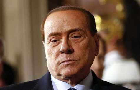 Leader of Forza Italia party Silvio Berlusconi arrives to talk to reporters at the end of the consultations with Italian President Giorgio N