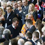 Liverpool manager Brendan Rodgers is applauded after speaking during a memorial service to mark the 25th anniversary of the Hillsborough dis