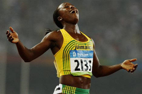 Veronica Campbell-Brown of Jamaica celebrates winning the women's 200m final of the athletics competition in the National Stadium at the Bei