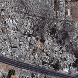 DigitalGlobe Satellite image shows a tank on 6th Rishreen road in the lower left portion of the image in Qabun neighborhood in Damascus, Syr