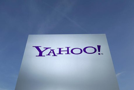 A Yahoo logo is pictured in front of a building in Rolle, 30 km (19 miles) east of Geneva, in this file picture taken December 12, 2012. REU