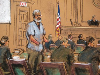 Abu Hamza al-Masri, the radical Islamist cleric facing U.S. terrorism charges, stands with his legal team in Manhattan federal court in New