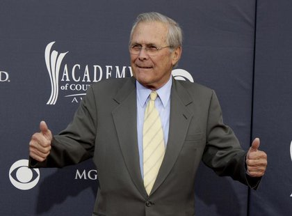 Former U.S. Secretary of Defense Donald Rumsfeld arrives at the 46th annual Academy of Country Music Awards in Las Vegas April 3, 2011. REUT