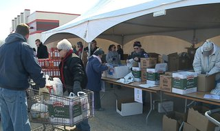 Feeding America Eastern Wisconsin brought its mobile food pantry to Appleton on Tuesday, April 15, 2014. (Photo from: FOX 11.)