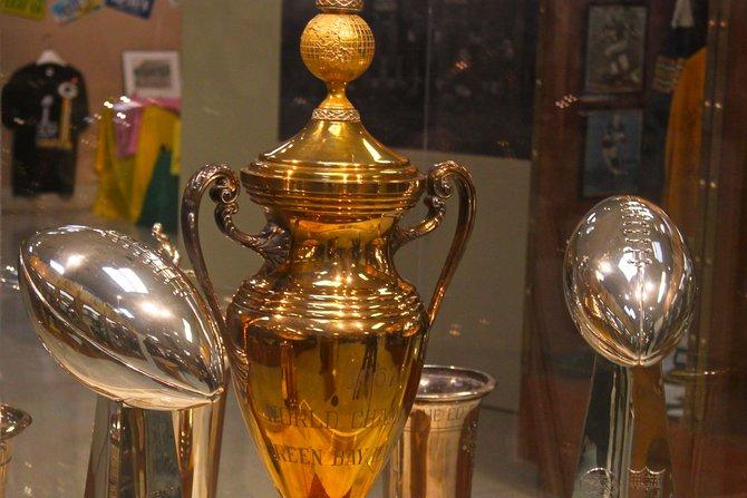 Super Bowl I and II trophies