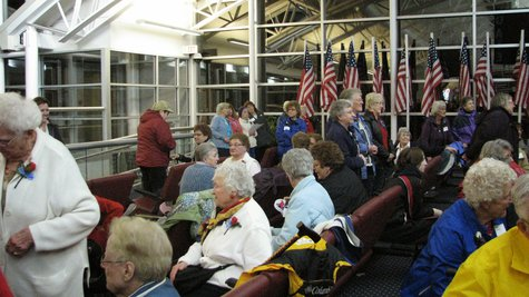 Families and spouses wait for their returning veterans from the Never Forgotten Honor Flight (photo taken by Raymond Neupert, 04/14/14)