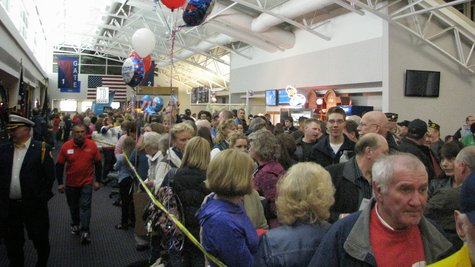 Crowds pack Central Wisconsin Airport waiting for vets returning from the Never Forgotten Honor Flight (taken by Raymond Neupert, 04/14/14)