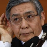Bank of Japan Governor Haruhiko Kuroda gestures as he listens to questions from a reporter during a news conference at the BOJ headquarters