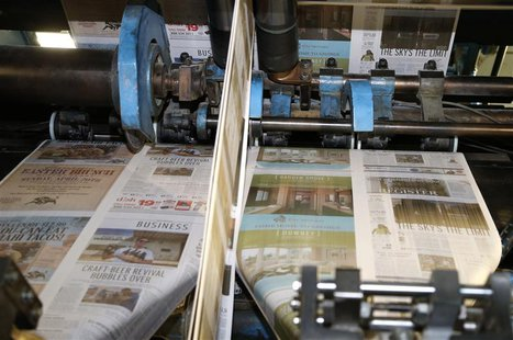 The first copies of the inaugural Los Angeles Register newspaper run off the presses in Santa Ana, California April 16, 2014. REUTERS/Lucy N