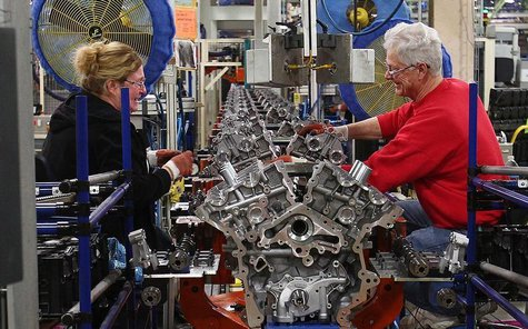 Ford assembly line employees work on 3500 Duramax engine as they move along the assembly line at the Ford Lima Engine Plant in Lima, Ohio, M