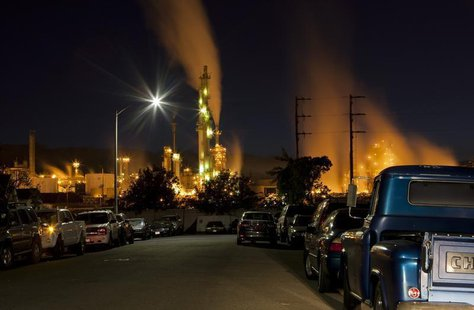 The ConocoPhillips oil refinery lights up a neighborhood in San Pedro, California March 24, 2012. Picture taken March 24, 2012. REUTERS/Bret