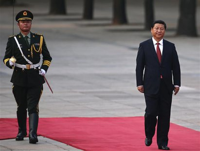 China's President Xi Jinping walks next to a honour guard during the welcoming ceremony for Serbian President Tomislav Nikolic outside the G