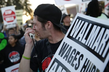 A man chants outside Wal-Mart during a protest for better wages and working conditions during Black Friday in San Leandro, California Novemb