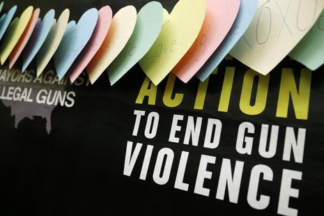 A backdrop is pictured during a news conference held by groups Mayors Against Illegal Guns and Moms Demand Action for Gun Sense in America,