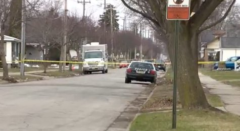 Green Bay Police investigate fatal shooting in the 1100 block of Stuart Street on April 16, 2014. (Photo from: YouTube).