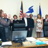 City Clerk Sue Richards administers oath of office