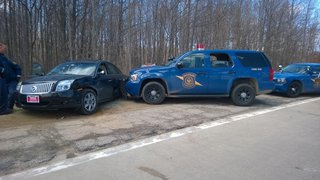 Troopers wasted no time pinning his Sable  once he left the road. (pictures courtesy Michigan State Police)