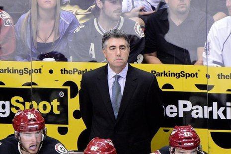 Oct 22, 2013; Glendale, AZ, USA; Phoenix Coyotes head coach Dave Tippett looks on during the third period against the Calgary Flames at Jobi