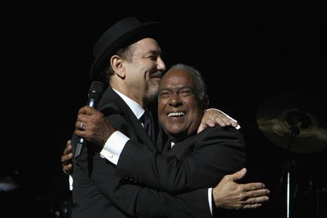"Puerto Rican salsa singer Jose ""Cheo"" Feliciano (R) embraces Panamanian singer Ruben Blades during Blades' initial concert of his new tour """
