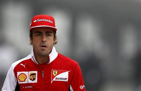 Ferrari Formula One driver Fernando Alonso of Spain arrives for a news conference ahead of the Chinese F1 Grand Prix at the Shanghai Interna