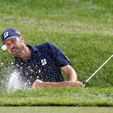 Matt Kuchar of the U.S. hits from the sand on the 16th hole during the third round of the Memorial Tournament at Muirfield Village Golf Club