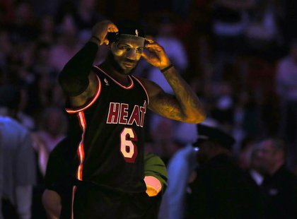 Mar 1, 2014; Miami, FL, USA; Miami Heat small forward LeBron James (6) adjusts his mask before a game against the Orlando Magic at American