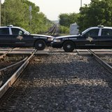 Texas State Troopers block a railway line leading towards a fertilizer plant explosion in the town of West, near Waco, Texas April 20, 2013.