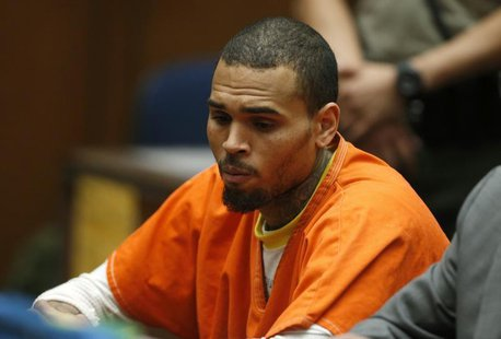 R&B singer Chris Brown, who pleaded guilty to assaulting his girlfriend Rihanna, appears in court for allegedly violating his probation, in