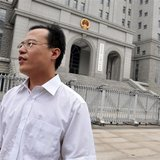 Lawyer Hao Junbo stands outside a court in Beijing, in this picture taken August 18, 2009. REUTERS/Stringer