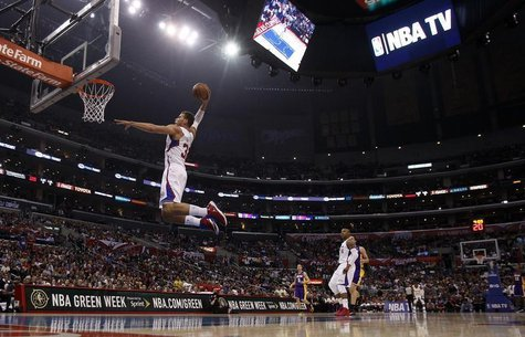 Los Angeles Clippers forward Blake Griffin (L) leaps for a dunk against the Los Angeles Lakers during the first half of their NBA basketball