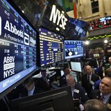 Traders gather at the booth that trades Abbott Laboratories on the floor of the New York Stock Exchange in this file photo taken December 10
