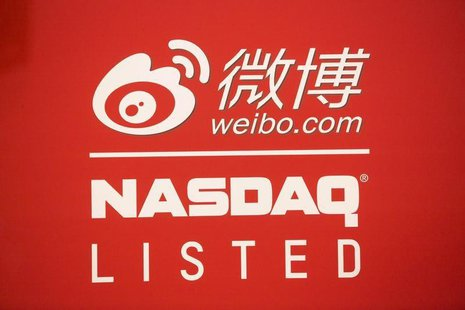 Signage for Weibo Corporation is seen at the NASDAQ MarketSite in Times Square on day one of its initial public offering (IPO) on The NASDAQ