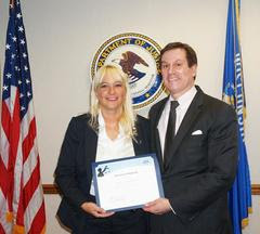 Sheboygan Police Detective Tamara Remington poses with DOJ Attorney James Santelle with her recognition.