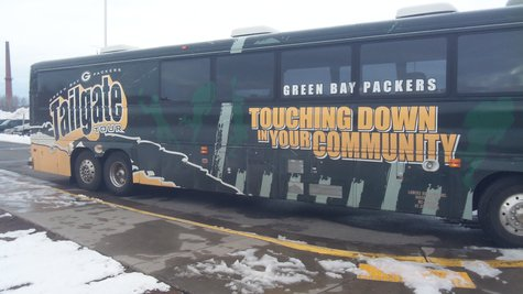 Green Bay Packers Tailgate Tour bus outside Superior High School