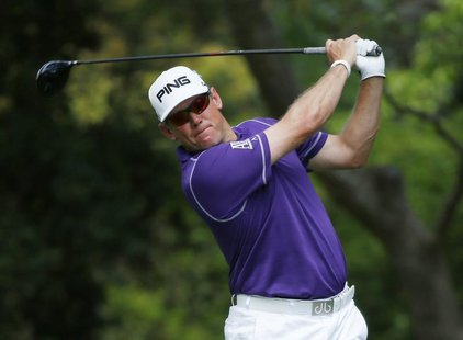 Britain's Lee Westwood hits his tee shot on the second hole during the final round of the Masters golf tournament at the Augusta National Go