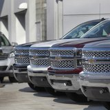 A man walks past a row of General Motors vehicles at a Chevrolet dealership on Woodward Avenue in Detroit, Michigan April 1, 2014. REUTERS/R