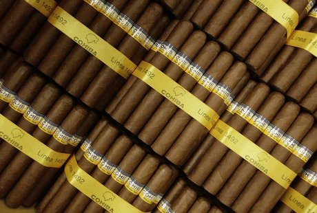 Cigars ready to put in boxes are pictured in Havana on March 1, 2013. REUTERS/Desmond Boylan