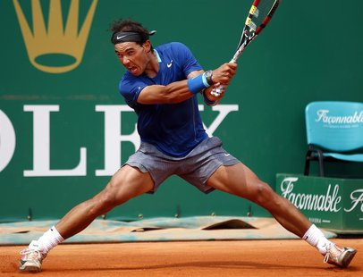Rafael Nadal of Spain returns the ball to his compatriot David Ferrer during their quarter-final match at the Monte Carlo Masters in Monaco