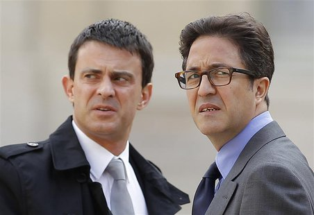 Manuel Valls (L), who is France's current Prime Minister, and Aquilino Morelle, French politician and former person in charge of the preside