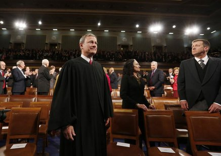 U.S. Supreme Court Chief Justice John Roberts arrives prior to President Barack Obama's State of the Union speech on Capitol Hill in Washing
