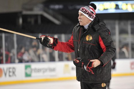 Feb 28, 2014; Chicago, IL, USA; Chicago Blackhawks head coach Joel Quenneville during practice the day before a Stadium Series hockey game a