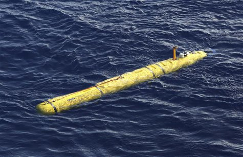 The Bluefin-21 Autonomous Underwater Vehicle sits in the water after being deployed from the Australian Defence Vessel Ocean Shield in the s