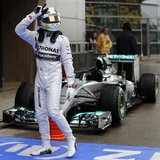 Mercedes Formula One driver Lewis Hamilton of Britain gestures while celebrating after taking pole position at the qualifying session of the
