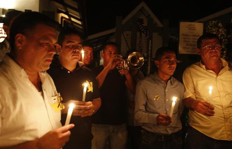 Residents hold lighted candles as they pay homage in front of the house of Colombian Nobel Prize laureate Gabriel Garcia Marquez in Aracatac