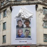 A poster calling for the release of French journalists Didier Francois, Edouard Elias, Nicolas Henin and Pierre Torres is installed on the f
