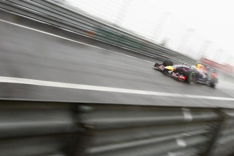 Red Bull Racing Formula One driver Sebastian Vettel of Germany drives during the qualifying session for the Chinese F1 Grand Prix at the Sha